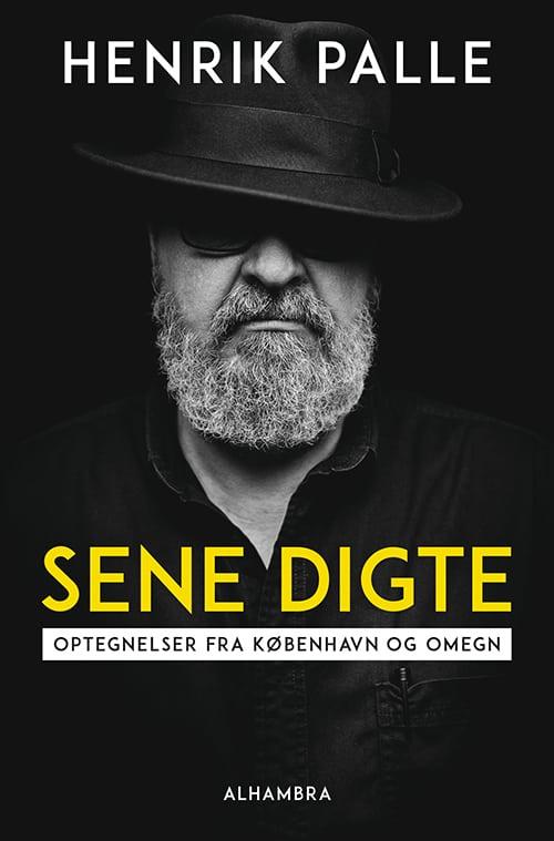 """Henrik Palle med hat og """"Sene digte""""."""